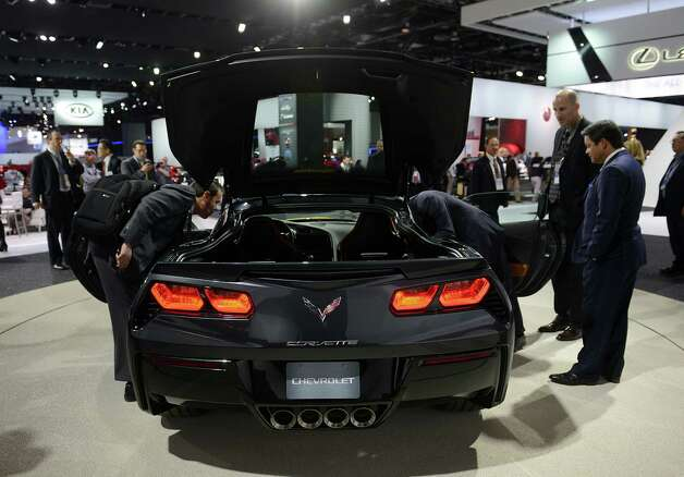 Attendees view the 2014 Chevrolet Corvette Stingray during the 2013 North American International Auto Show (NAIAS) in Detroit, Michigan, U.S., on Tuesday, Jan. 15, 2013. The Detroit auto show runs through Jan. 27 and will display over 500 vehicles, representing the most innovative designs in the world. Photographer: David Paul Morris/Bloomberg Photo: David Paul Morris, Bloomberg / © 2013 Bloomberg Finance LP