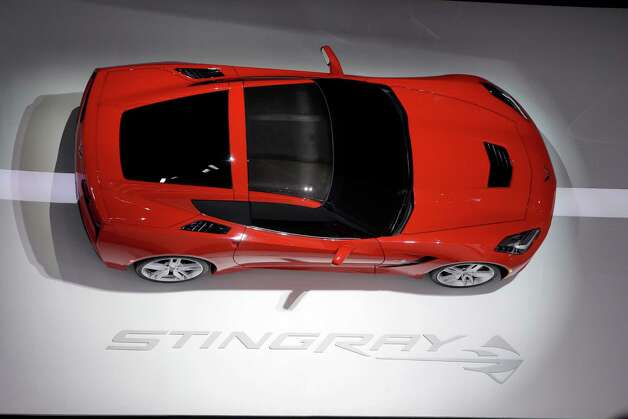 A Chevrolet Corvette Stingray is displayed at the North American International Auto Show in Detroit, Tuesday, Jan. 15, 2013. (AP Photo/Carlos Osorio) Photo: Carlos Osorio, Associated Press / AP