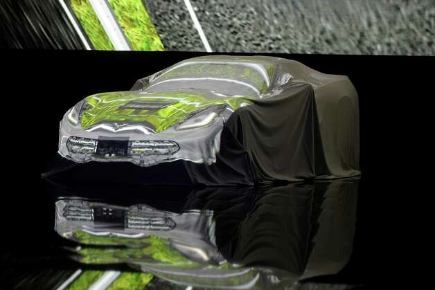 The 2014 Chevrolet Corvette Stingray sits covered during the unveiling ahead of the 2013 North American International Auto Show (NAIAS) in Detroit, Michigan, U.S., on Sunday, Jan. 13, 2013. The new model, set to reach dealers in this year's third quarter, is part of the push to breathe new life into the Chevy brand, which accounted for 71 percent of GM's 2012 U.S. sales. Photographer: Daniel Acker/Bloomberg Photo: Daniel Acker, Bloomberg / © 2013 Bloomberg Finance LP