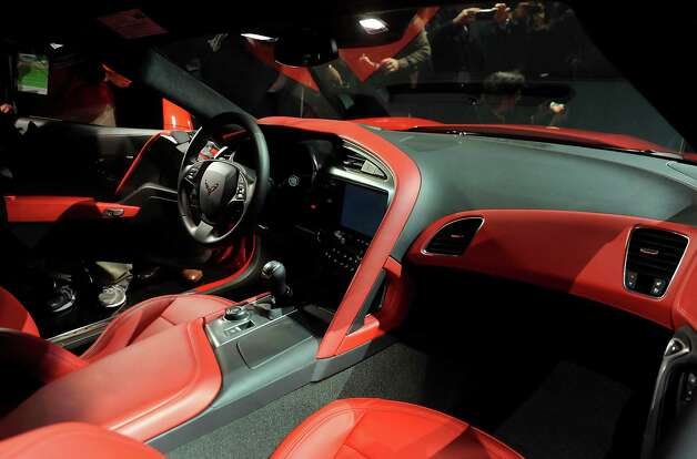The interior of the 2014 Chevrolet Corvette Stingray is seen after being unveiled ahead of the 2013 North American International Auto Show (NAIAS) in Detroit, Michigan, U.S., on Sunday, Jan. 13, 2013. The new model, set to reach dealers in this year's third quarter, is part of the push to breathe new life into the Chevy brand, which accounted for 71 percent of GM's 2012 U.S. sales. Photographer: Daniel Acker/Bloomberg Photo: Daniel Acker, Bloomberg / © 2013 Bloomberg Finance LP