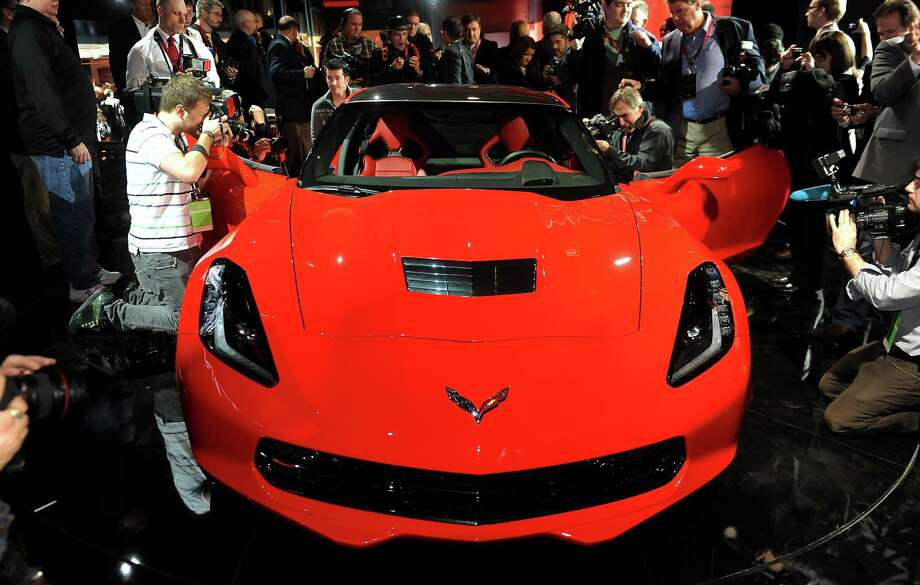 Photographers take pictures of the 2014 Chevrolet Corvette Stingray after the unveiling ahead of the 2013 North American International Auto Show (NAIAS) in Detroit, Michigan, U.S., on Sunday, Jan. 13, 2013. The new model, set to reach dealers in this year's third quarter, is part of the push to breathe new life into the Chevy brand, which accounted for 71 percent of GM's 2012 U.S. sales. Photographer: Daniel Acker/Bloomberg Photo: Daniel Acker, Bloomberg / © 2013 Bloomberg Finance LP
