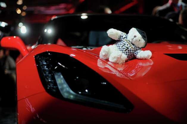 A teddy bear sits on top of the 2014 Chevrolet Corvette Stingray after the unveiling ahead of the 2013 North American International Auto Show (NAIAS) in Detroit, Michigan, U.S., on Sunday, Jan. 13, 2013. The new model, set to reach dealers in this year's third quarter, is part of the push to breathe new life into the Chevy brand, which accounted for 71 percent of GM's 2012 U.S. sales. Photographer: Daniel Acker/Bloomberg Photo: Daniel Acker, Bloomberg / © 2013 Bloomberg Finance LP