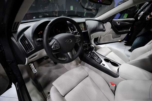 The interior of the Nissan Motor Co. Infiniti Q50 sedan is seen after being unveiled during the 2013 North American International Auto Show (NAIAS) in Detroit, Michigan, U.S., on Monday, Jan. 14, 2013. Nissan Motor Co.'s Infiniti, lagging larger German, Japanese and U.S. luxury brands, is replacing the G sedan with the Q50 sports car as the company links growth goals for its rechristened lineup to better looks and technology.