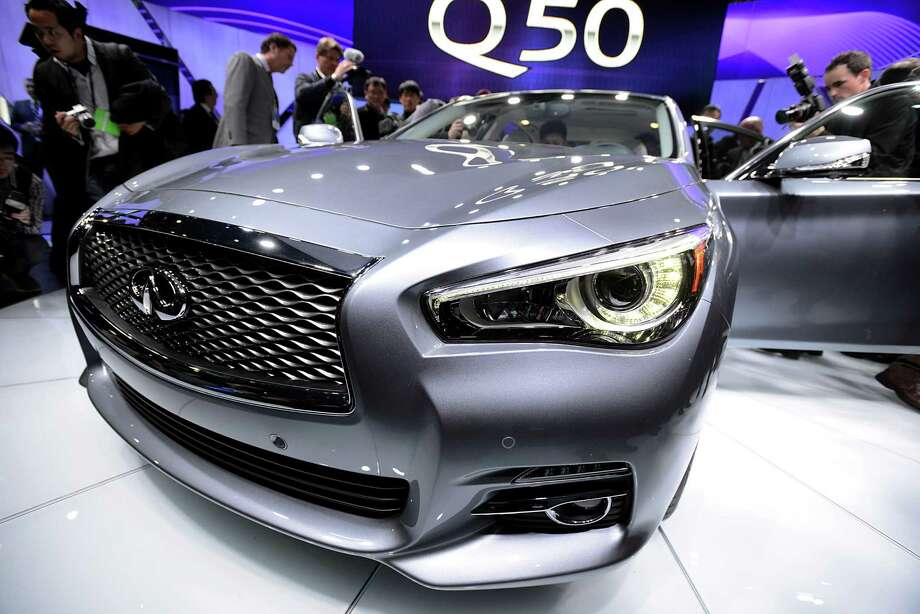 The Nissan Motor Co. Infiniti Q50 sedan is displayed after being unveiled during the 2013 North American International Auto Show (NAIAS) in Detroit, Michigan, U.S., on Monday, Jan. 14, 2013. Nissan Motor Co.'s Infiniti, lagging larger German, Japanese and U.S. luxury brands, is replacing the G sedan with the Q50 sports car as the company links growth goals for its rechristened lineup to better looks and technology.