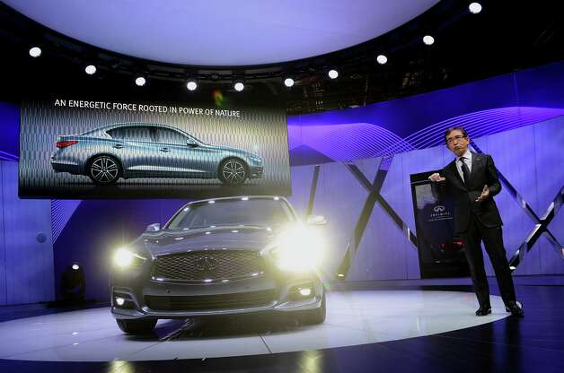 Shiro Nakamura, senior vice president of Nissan Motor Co., speaks during the unveiling of the Infiniti Q50 sedan at the 2013 North American International Auto Show (NAIAS) in Detroit, Michigan, U.S., on Monday, Jan. 14, 2013. Nissan Motor Co.'s Infiniti, lagging larger German, Japanese and U.S. luxury brands, is replacing the G sedan with the Q50 sports car as the company links growth goals for its rechristened lineup to better looks and technology. Photographer: Daniel Acker/Bloomberg *** Local Caption *** Shiro Nakamura Photo: Daniel Acker, Bloomberg / © 2013 Bloomberg Finance LP