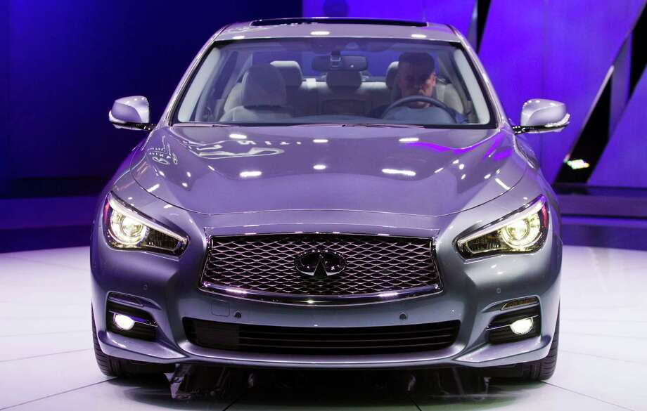 The Infiniti Q50 sedan is introduced at the North American International Auto Show, Monday, Jan. 14, 2013, in Detroit, Mich. (AP Photo/Tony Ding) Photo: TONY DING, Associated Press / FR143848 AP