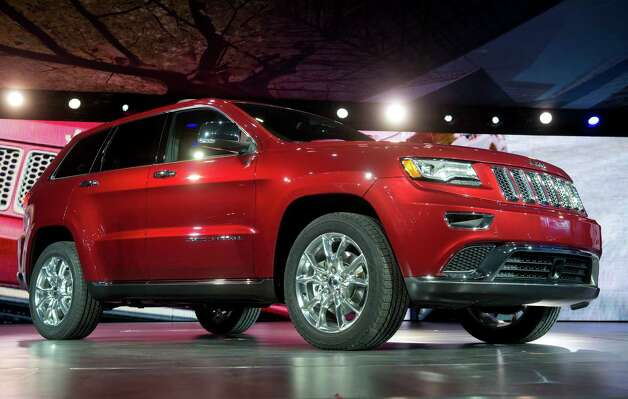 The Chrysler Group LLC 2014 Jeep Grand Cherokee sits during the unveiling at the 2013 North American International Auto Show (NAIAS) in Detroit, Michigan, U.S., on Monday, Jan. 14, 2013. The Detroit auto show runs through Jan. 27 and will display over 500 vehicles, representing the most innovative designs in the world. Photographer: Daniel Acker/Bloomberg Photo: Daniel Acker, Bloomberg / © 2013 Bloomberg Finance LP