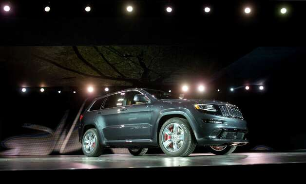 The Chrysler Group LLC 2014 Jeep Grand Cherokee SRT sits during the unveiling at the 2013 North American International Auto Show (NAIAS) in Detroit, Michigan, U.S., on Monday, Jan. 14, 2013. The Detroit auto show runs through Jan. 27 and will display over 500 vehicles, representing the most innovative designs in the world. Photographer: Daniel Acker/Bloomberg Photo: Daniel Acker, Bloomberg / © 2013 Bloomberg Finance LP