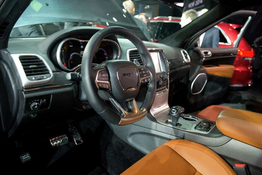 The interior of  the Chrysler Group LLC 2014 Jeep Grand Cherokee SRT is seen during the 2013 North American International Auto Show (NAIAS) in Detroit, Michigan, U.S., on Monday, Jan. 14, 2013. The Detroit auto show runs through Jan. 27 and will display over 500 vehicles, representing the most innovative designs in the world. Photographer: Daniel Acker/Bloomberg Photo: Daniel Acker, Bloomberg / © 2013 Bloomberg Finance LP