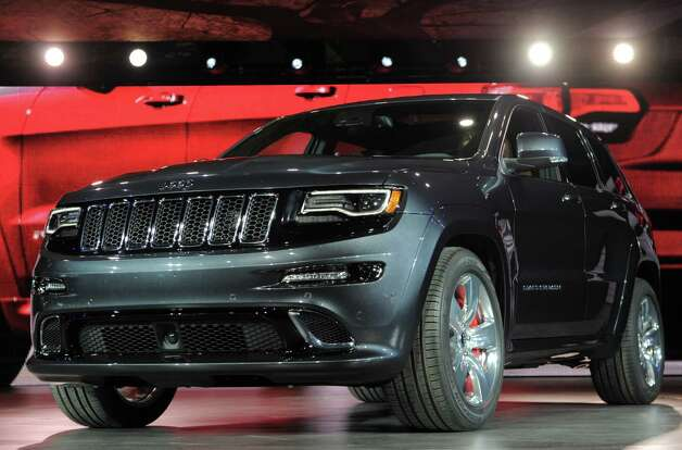 The 2014 Jeep Grand Cherokee SRT high performance version is introduced at the 2013 North American International Auto Show in Detroit, Michigan, January 14, 2013. AFP PHOTO/Stan HONDASTAN HONDA/AFP/Getty Images Photo: STAN HONDA, AFP/Getty Images / AFP