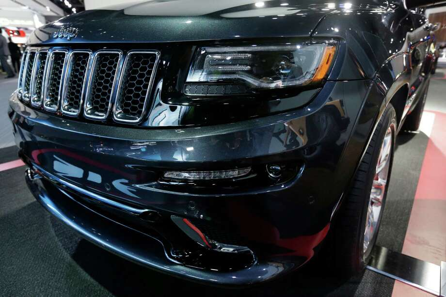 "The front lamps on the high-performance SRT version of the 2014 Jeep Grand Cherokee are seen at the North American International Auto Show in Detroit, Tuesday, Jan. 15, 2013. The lamps are tinted black, giving it a distinct look. And Ralph Gilles, a Chrysler design leader who also is president and CEO of the SRT brand and motorsports, noted the vehicle has black _ ""kind of like death"" _ headlamps. (AP Photo/Carlos Osorio) Photo: Carlos Osorio, Associated Press / AP"