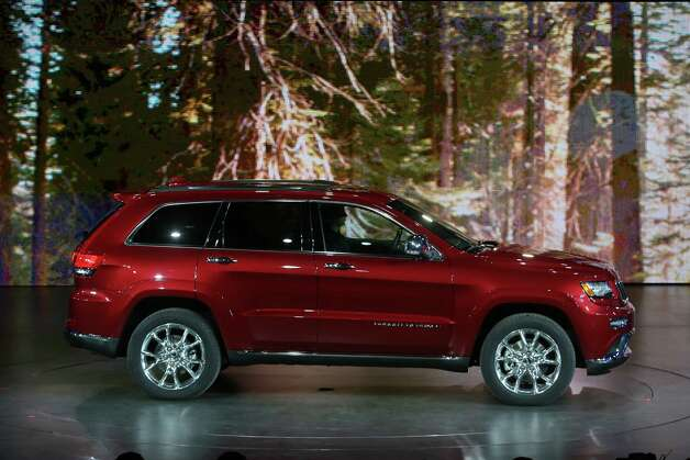 Chrysler unveils the upgraded 2014 Jeep Grand Cherokee with eight-speed transmission and diesel engine during the 2013 North American International Auto Show at Cobo Center on Monday, January 14, 2013, in Detroit, Michigan. (Mandi Wright/Detroit Free Press/MCT) Photo: Mandi Wright, McClatchy-Tribune News Service / Detroit Free Press