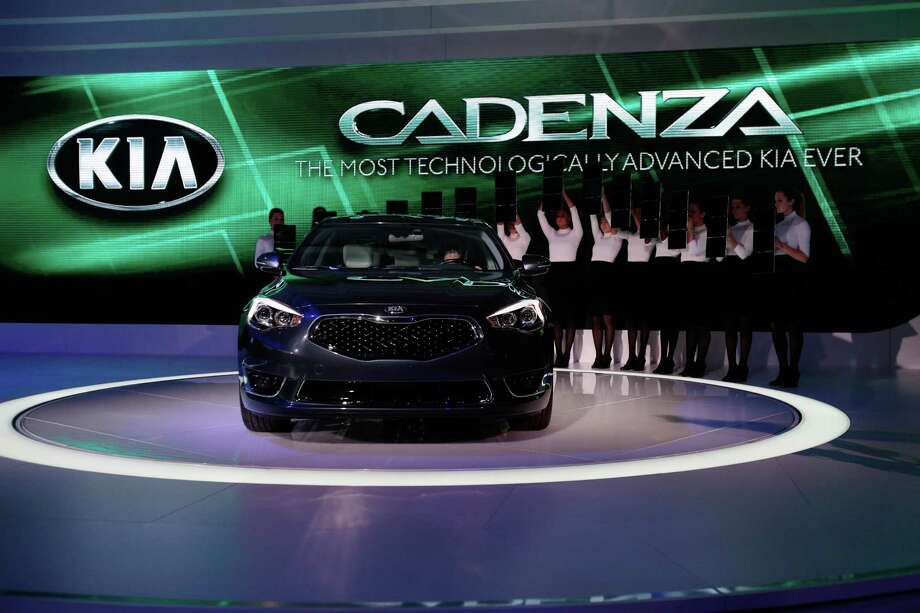 The Kia Cadenza is introduced at the 2013 North American International Auto Show in Detroit, Michigan, on January 15, 2013.    AFP PHOTO/Geoff RobinsGEOFF ROBINS/AFP/Getty Images Photo: GEOFF ROBINS, AFP/Getty Images / AFP