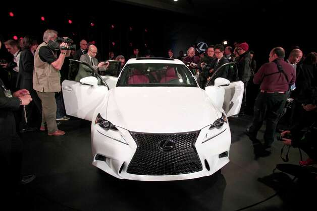 DETROIT, MI - JANUARY 15: The Lexus IS 350 F Sport makes its world debut at the 2013 North American International Auto Show media preview at the Cobo Center January 15, 2013 in Detroit, Michigan. Approximately 6,000 members of the media from 68 countries are attending the show this year. The 2013 NAIAS opens to the public  January 19th. Photo: Bill Pugliano, Getty Images / 2013 Getty Images