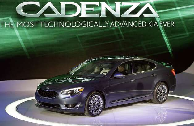 The Kia Cadenza is unveiled at the North American International Auto Show in Detroit, Tuesday, Jan. 15, 2013. (AP Photo/Carlos Osorio) Photo: Carlos Osorio, Associated Press / AP