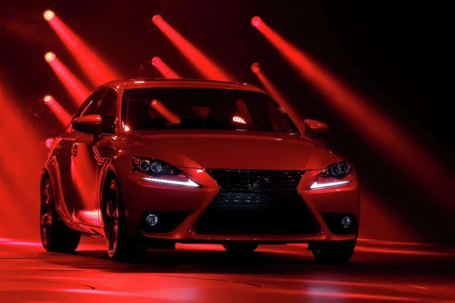 The Lexus IS 300h debuts at media previews for the North American International Auto Show in Detroit, Tuesday, Jan. 15, 2013.  (AP Photo/Paul Sancya) Photo: Paul Sancya, Associated Press / AP
