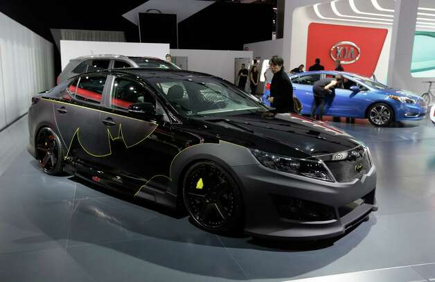 "The Batman-decorated Kia Optima is displayed at the North American International Auto Show in Detroit, Tuesday, Jan. 15, 2013. The comic inspired auto at the South Korean automaker's exhibit was created to promote an effort to fight hunger in Africa. Features include Batman symbols inside and outside on the Optima and was created as part of a partnership involving DC Entertainment. The ""We Can Be Heroes"" effort is promoted in part by the use of Justice League characters. (AP Photo/Carlos Osorio) Photo: Carlos Osorio, Associated Press / AP"