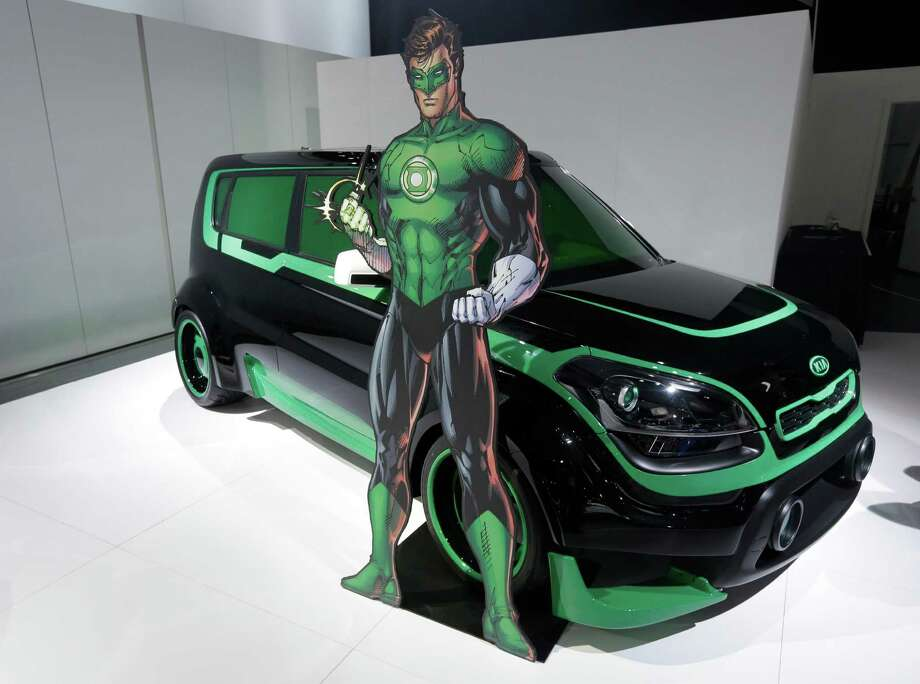 "The Green Lantern-wrapped Kia Soul is on display at the North American International Auto Show in Detroit, Tuesday, Jan. 15, 2013. The Batman-decorated Kia Optima and the Green Lantern-wrapped Kia Soul are at the South Korean automaker's exhibit to promote an effort to fight hunger in Africa. Features include the Green Lantern's symbol on the Soul's wheels. The vehicles were created as part of a partnership involving DC Entertainment. The ""We Can Be Heroes"" effort is promoted in part by the use of Justice League characters. (AP Photo/Carlos Osorio) Photo: Carlos Osorio, Associated Press / AP"