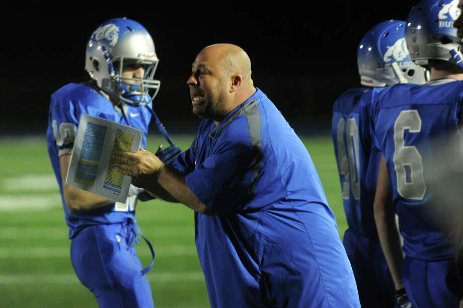 Bunnell's Head Coach Craig Bruno gives instructions to a player during a game against Pomperaug. Photo: Christian Abraham / Connecticut Post