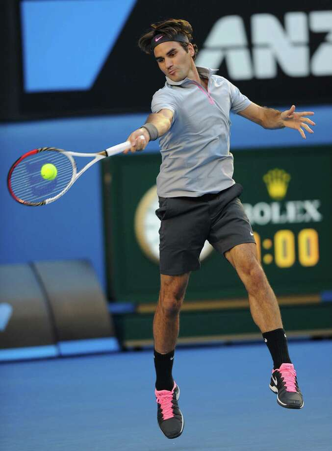 Switzerland's Roger Federer hits a forehand return to Russia's Nikolay Davydenko during their second round match at the Australian Open tennis championship in Melbourne, Australia, Thursday, Jan. 17, 2013. (AP Photo/Andrew Brownbill) Photo: Andrew Brownbill