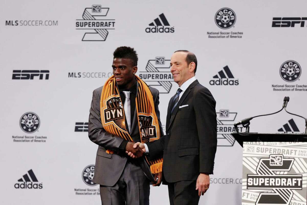 INDIANAPOLIS, IN - JANUARY 17: Jason Johnson of VCU shakes hands with commissioner Don Garber after being selected by the Houston Dynamo as the 13th overall pick in the 2013 MLS SuperDraft Presented by Adidas at the Indiana Convention Center on January 17, 2013 in Indianapolis, Indiana.