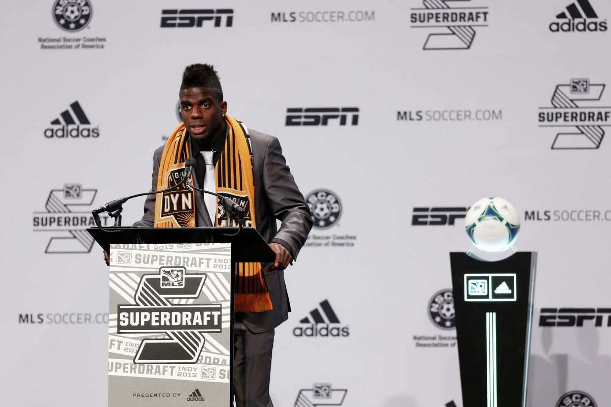 Jason Johnson speaks to the crowd after being selected by the Houston Dynamo as the 13th overall pick in the 2013 MLS SuperDraft. (Joe Robbins / Getty Images)