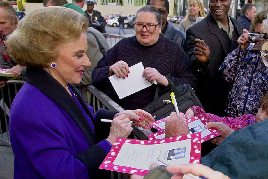 "FILE - In this Feb. 14, 2001 file photo, ""Dear Abby"" advice columnist Pauline Friedman Phillips, 82, known to millions of readers as Abigail van Buren, signs autographs for some of dozens of fans after the dedication of a ""Dear Abby"" star on the Hollywood Walk of Fame in Los Angeles.  Phillips, who had Alzheimer's disease, died Wednesday, Jan. 16, 2013, she was 94.  Phillips' column competed for decades with the advice column of Ann Landers, written by her twin sister, Esther Friedman Lederer. Their relationship was stormy in their early adult years, but later they regained the close relationship they had growing up in Sioux City, Iowa. The two columns differed in style. Ann Landers responded to questioners with homey, detailed advice. Abby's replies were often flippant one-liners. (AP Photo/Reed Saxon) Photo: REED SAXON"