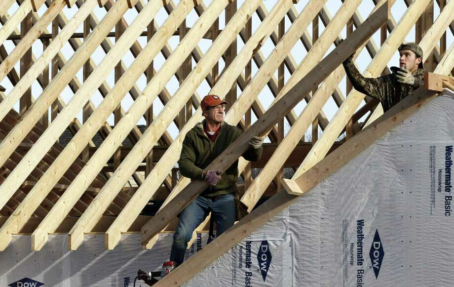 In this Thursday, Dec. 6, 2012, photo a new home is constructed in Pepper Pike, Ohio. US home construction surges 12.1 percent in December to end best year since 2008. (AP Photo/Tony Dejak) Photo: Tony Dejak