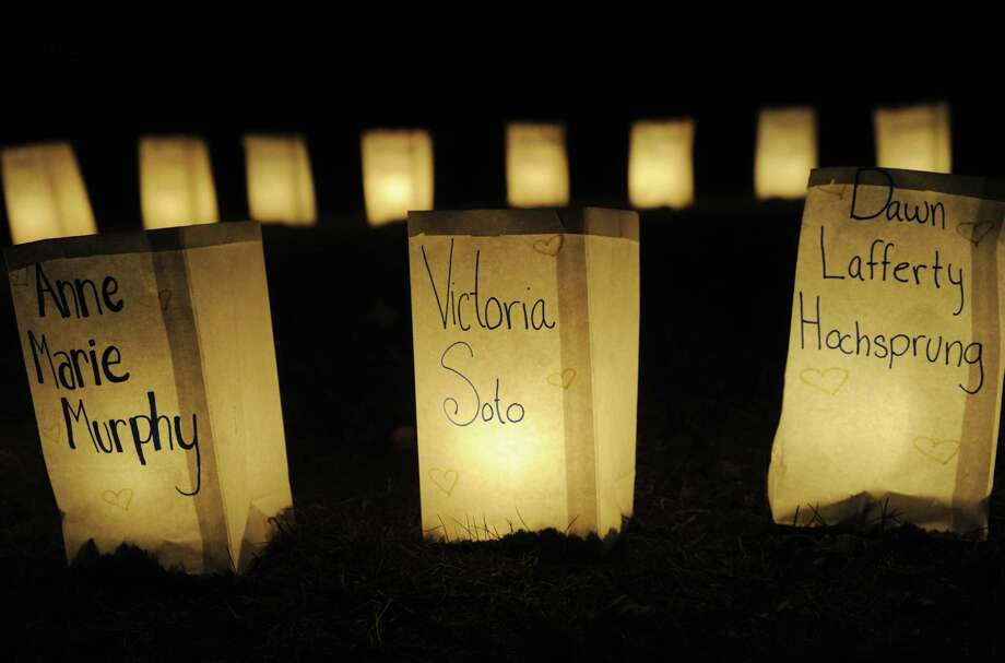 Luminarias carry the names of the Sandy Hook Elementary shooting victims on Charter Ridge in Newtown on Monday, December 24, 2012. The luminaria bags were distributed free to residents at several town retailers. Photo: Brian A. Pounds, Connecticut Post / Connecticut Post