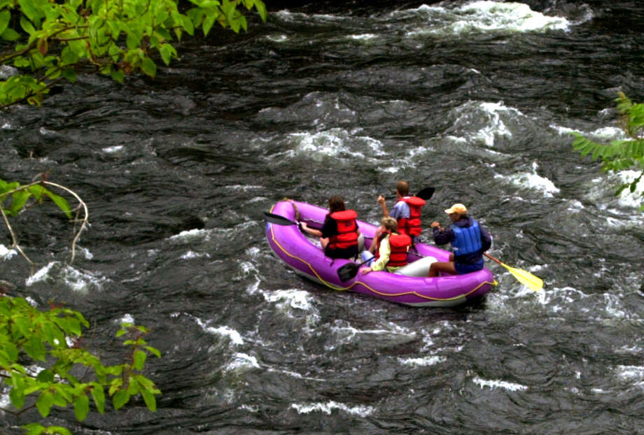 A tour boat operated by Hudson River Rafting is guided down the Sacandaga River Sunday, July 8, 2001, in Hadley, N.Y. (Cindy Schultz / Times Union archive) Photo: CINDY SCHULTZ