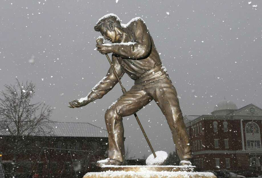 Snow falls on an Elvis Presley statue in downtown Tupelo, Mississippi on Thursday, Jan. 17, 2013.  At least one death has been linked to a winter storm system that dumped 2 to 4 inches of snow in central parts of Mississippi on Thursday. Photo: C. Todd Sherman, Associated Press / THE Northeast Ms Daily Journal