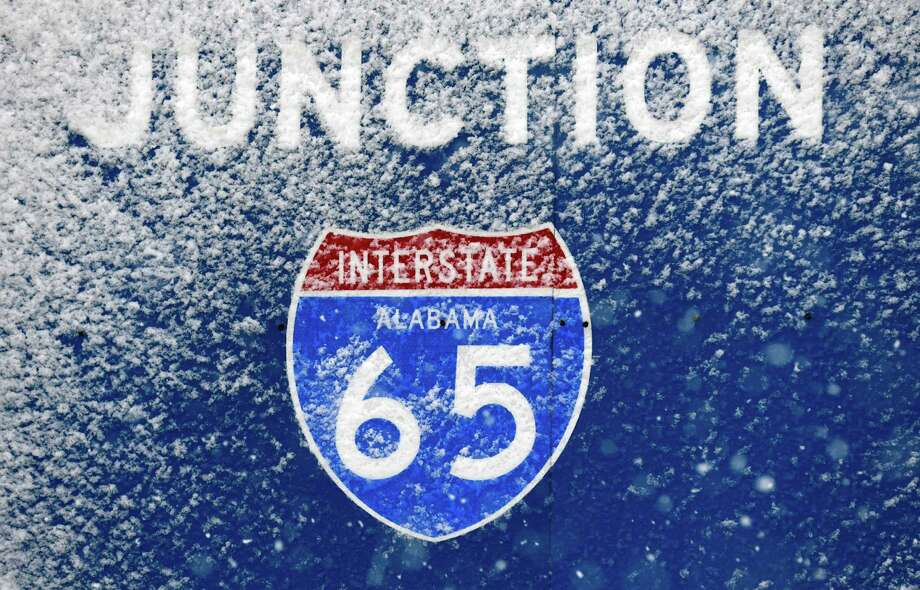 Snow covers a road sign in Decatur, Ala., Thursday, Jan. 17, 2013. Snow fell in Central and North Alabama, sending kids home from schools early along with other closures. Photo: Dave Martin, Associated Press / AP