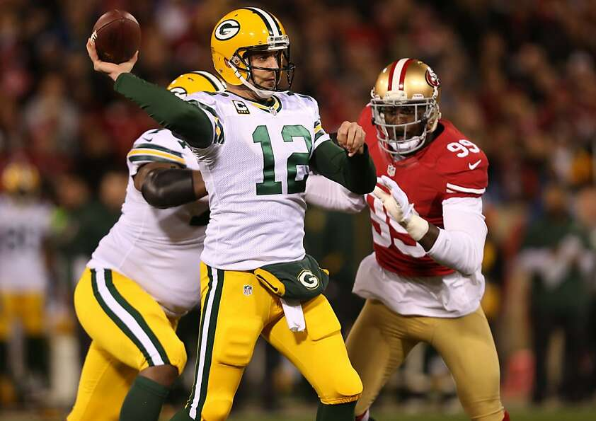 Niners linebacker Aldon Smith pressures Packers quarterback Aaron Rodgers on Saturday.