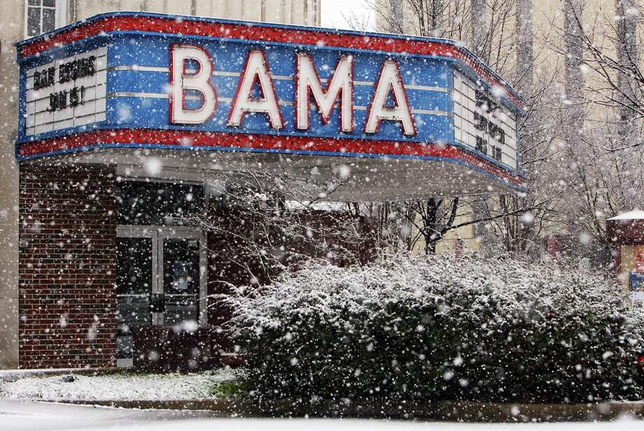 Snow falls outside the Bama Theatre in downtown Tuscaloosa Thursday, Jan. 17, 2013. Heavy snow fell across Tuscaloosa County Thursday. Photo: Michelle Lepianka Carter, Associated Press / Tuscaloosa News