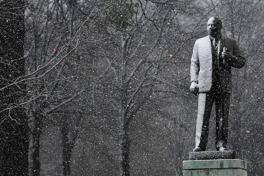 Snow accumulates on the Martin Luther King Jr. statue in Kelly Ingram Park in downtown Birmingham, Thursday, Jan. 17, 2013, as winter weather fell across central Alabama. Photo: Tamika Moore, Associated Press / AL.com