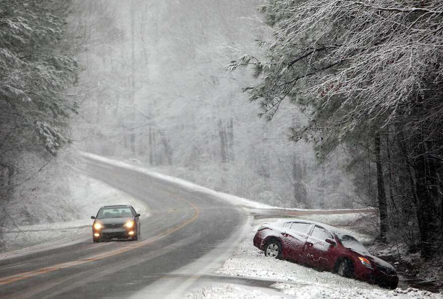 A vehicle that slid off Hwy 86 near Carrollton, Ala. is seen Thursday, Jan. 17, 2013. State Troopers