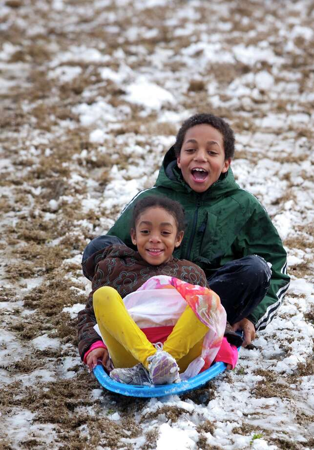 Emmanuel Ashford, 10, and his sister Alessandra, 5, sled down a hill on Thursday afternoon Jan. 17, 2013 in Tuscaloosa, Ala. Photo: Robert Sutton, Associated Press / The Tuscaloosa News