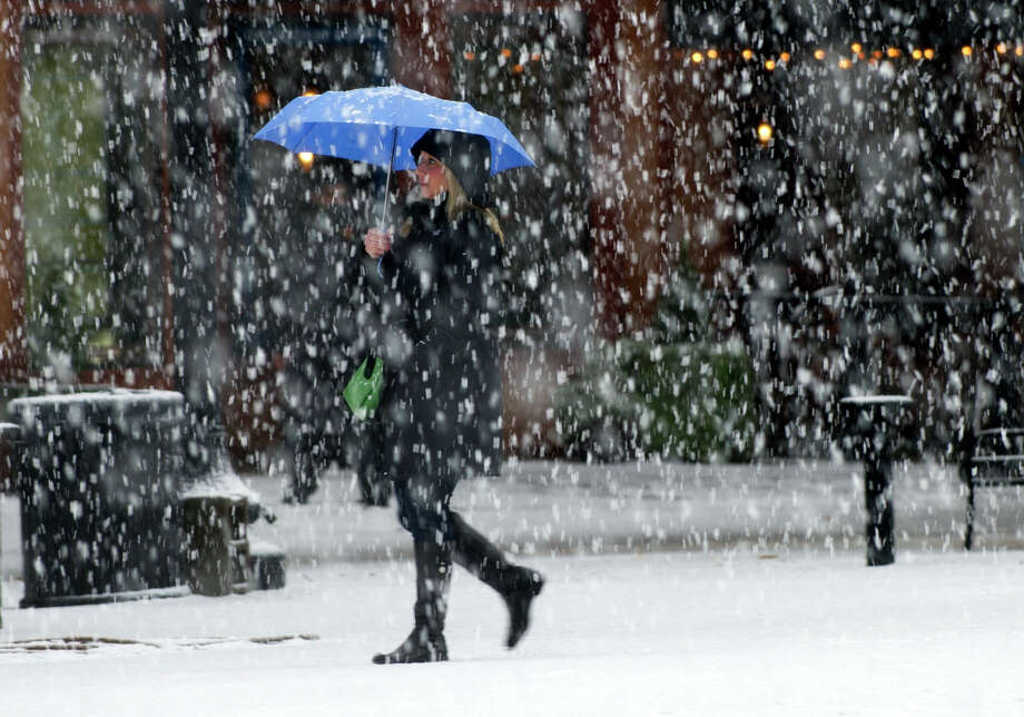 A woman walks during a heavy snowfall Thursday, Jan. 17, 2013, in Knoxville, Tenn.   A winter storm was making its way across the Southeast on Thursday, dumping 4 inches of snow in Mississippi and playing a role in a traffic fatality there, with the system expected to spread across northern Georgia and into the Carolinas and Virginia, according to the National Weather Service. Photo: Adam Brimer, Associated Press / Knoxville News Sentinel