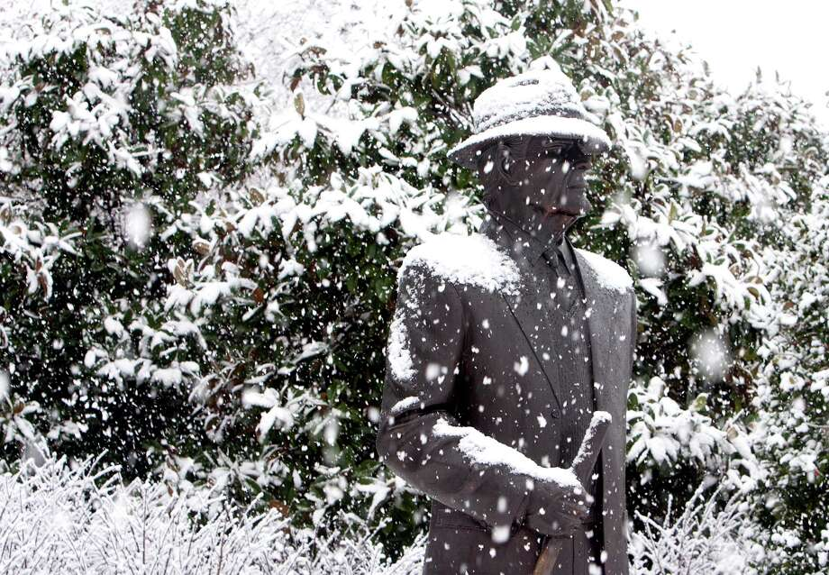 "Snow accumulates on the statue of Paul ""Bear"" Bryant on Thursday Jan. 17, 2013 on the University of Alabama campus in Tuscaloosa, Ala. Photo: Robert Sutton, Associated Press / The Tuscaloosa News"
