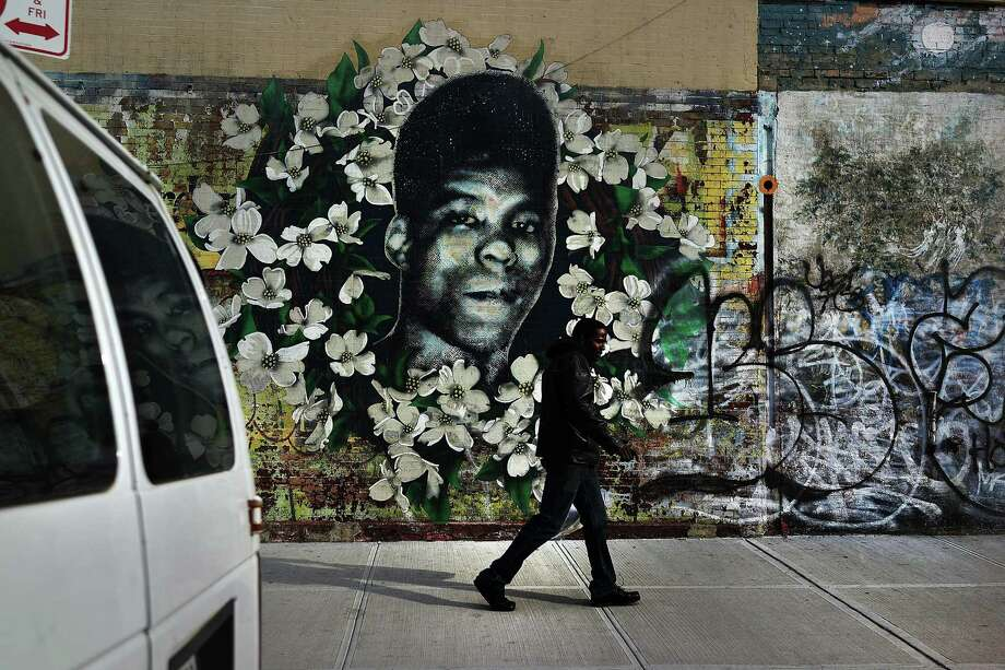 NEW YORK, NY - JANUARY 17:  A man walks by a walks by a graffiti memorial in memory of Yusef Hawkins, a 16-year-old African American youth who was shot to death on August 23, 1989 in Bensonhurst, on January 17, 2013 in the Brooklyn borough of New York City. Visual memorials honoring residents who in many cases met violent ends decorate many Brooklyn neighborhoods. New York Governor Andrew Cuomo recently signed into law the New York Secure Ammunition and Firearms Enforcement Act, one of the toughest gun laws in the country. (Photo by Spencer Platt/Getty Images) Photo: Spencer Platt