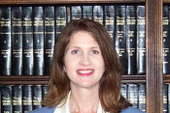 "Caption: Judge Elizabeth E. Coker oversees the 258th district court that covers Polk, San Jacinto and Trinity counties. Coker is accused of the ""very unethical"" practice of sending text messages from the bench to an assistant district attorney to help bolster the prosecution's case during a trial, according to an investigator's report.   Credit: Trinity County"