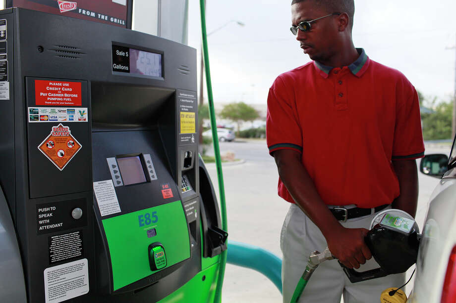 Dwight Barron Jones fills up his taxi with E85 fuel at a Valero in San Antonio. Critics of ethanol blends say the fuel could damage engines not designed for it. Photo: LISA KRANTZ, STAFF / Freelance