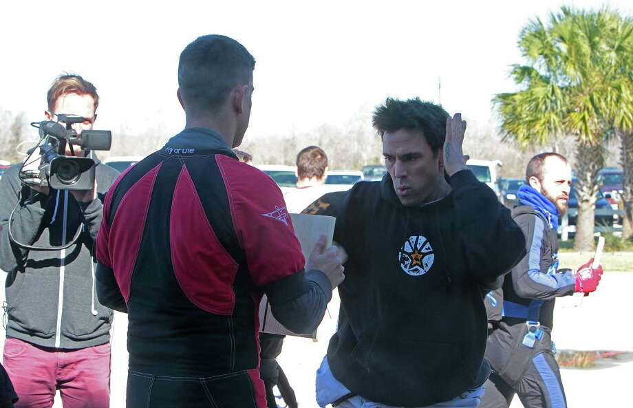"Jason David Frank, right, during a practice prior to an attempt at breaking the ""Most pine boards broken in freefall""  Guinness World Record while skydiving at Skydive Spaceland. Photo: James Nielsen, Chronicle / © Houston Chronicle 2013"