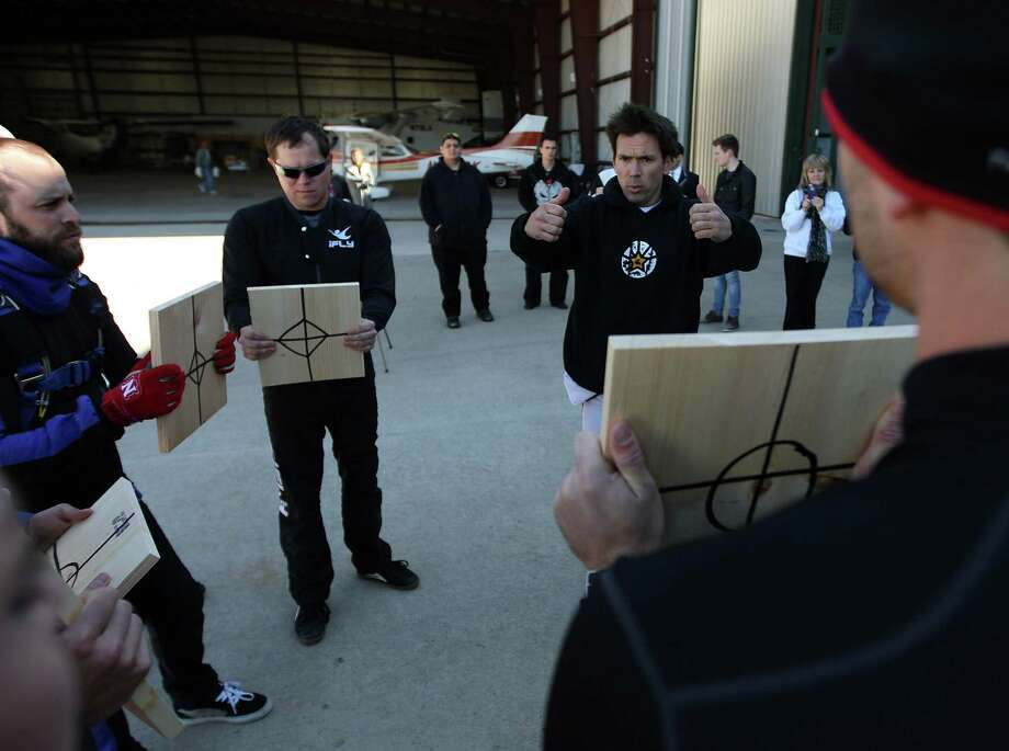 "Jason David Frank, right, during a practice prior to an attempt at breaking the ""Most pine boards broken in freefall""  Guinness World Record. Photo: James Nielsen, Chronicle / © Houston Chronicle 2013"