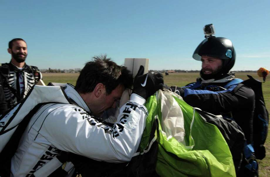 "Jason David Frank breaks a pine board with his head on the ground after breaking the ""Most pine boards broken in freefall""  Guinness World Record while skydiving at Skydive Spaceland Thursday, Jan. 17, 2013, in Rosharon. Frank broke 7 pine boards to break the existing record of 2 pine boards. Photo: James Nielsen, Chronicle / © Houston Chronicle 2013"