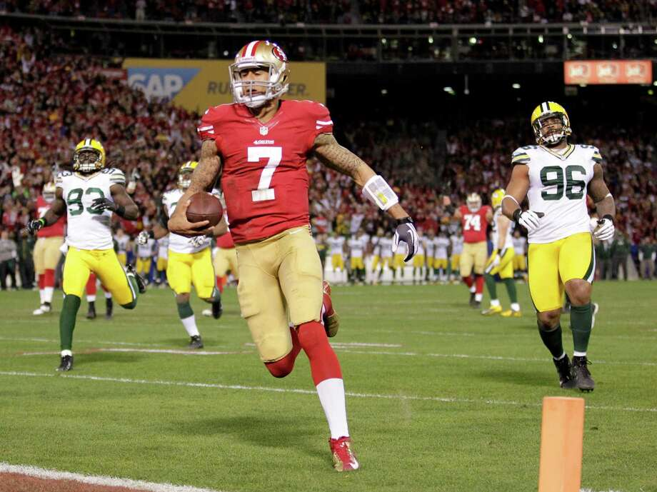 49ers quarterback Colin Kaepernick (7) ran for an NFL-record 181 yards and two touchdowns, including this 20-yard scoring run, in last week's victory over Green Bay. He also threw for 263 yards with two TDs. Photo: Tony Avelar, FRE / FR155217 AP