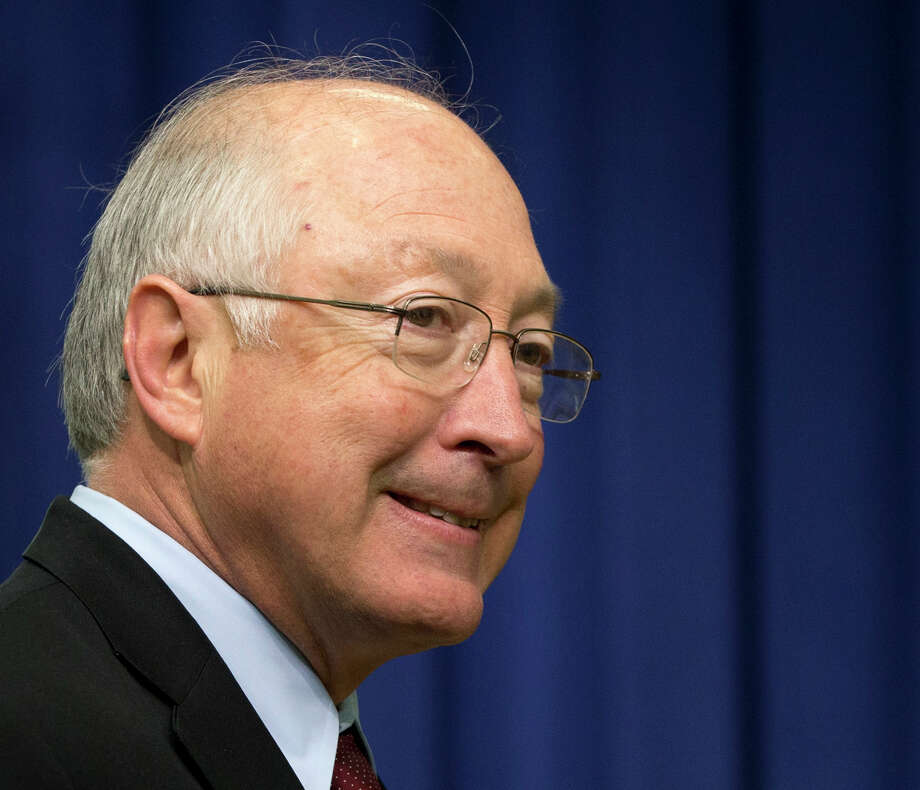 FILE - This Jan. 16, 2013 file photo shows outgoing Interior Secretary Ken Salazar entering the South Court Auditorium at the White House in Washington. The White House says tackling climate change and enhancing energy security will be among President Barack Obama's top priorities in his second term. Obama will have to do that work with new heads of the agencies responsible for the environment. Interior Secretary Ken Salazar, Environmental Protection chief Lisa Jackson and Jane Lubchenco, head of the National Oceanic and Atmospheric Administration, all have announced they are leaving. Energy Secretary Steven Chu is expected to follow his colleagues out the door in coming weeks. (AP Photo/Carolyn Kaster, File) Photo: Carolyn Kaster