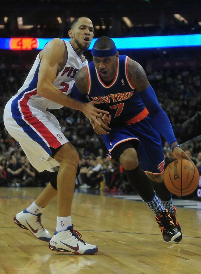 The Knicks' Carmelo Anthony dribbles by the Pistons' Tayshaun Prince at London's O2 Arena. Photo: Jamie McDonald, Getty Images