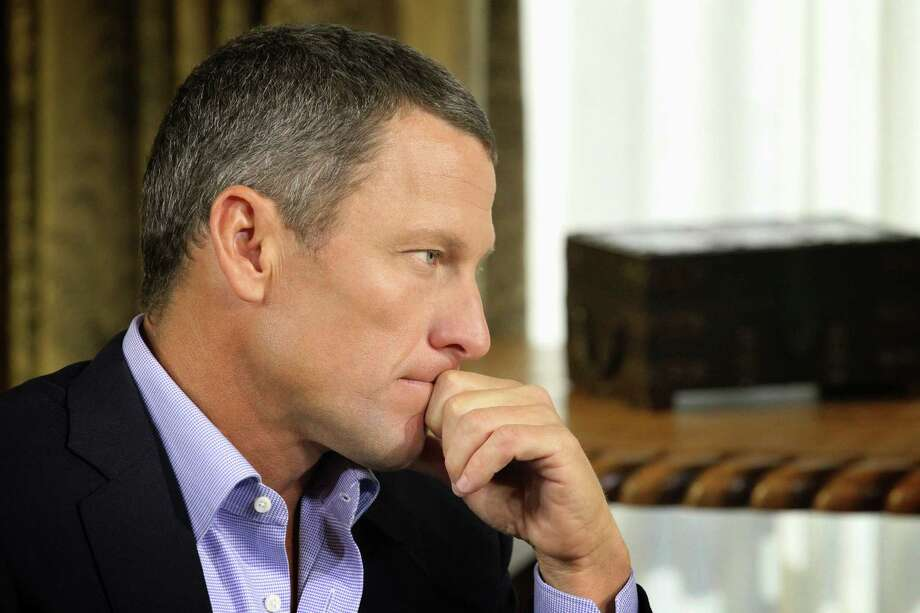"""FILE - In this Monday, Jan. 14, 2013, file photo provided by Harpo Studios Inc., Lance Armstrong listens as he is interviewed by talk show host Oprah Winfrey during taping for the show """"Oprah and Lance Armstrong: The Worldwide Exclusive"""" in Austin, Texas. Armstrong confessed to using performance-enhancing drugs to win the Tour de France cycling during the interview that aired Thursday, Jan. 17, reversing more than a decade of denial. (AP Photo/Courtesy of Harpo Studios, Inc., George Burns, File) Photo: George Burns"""