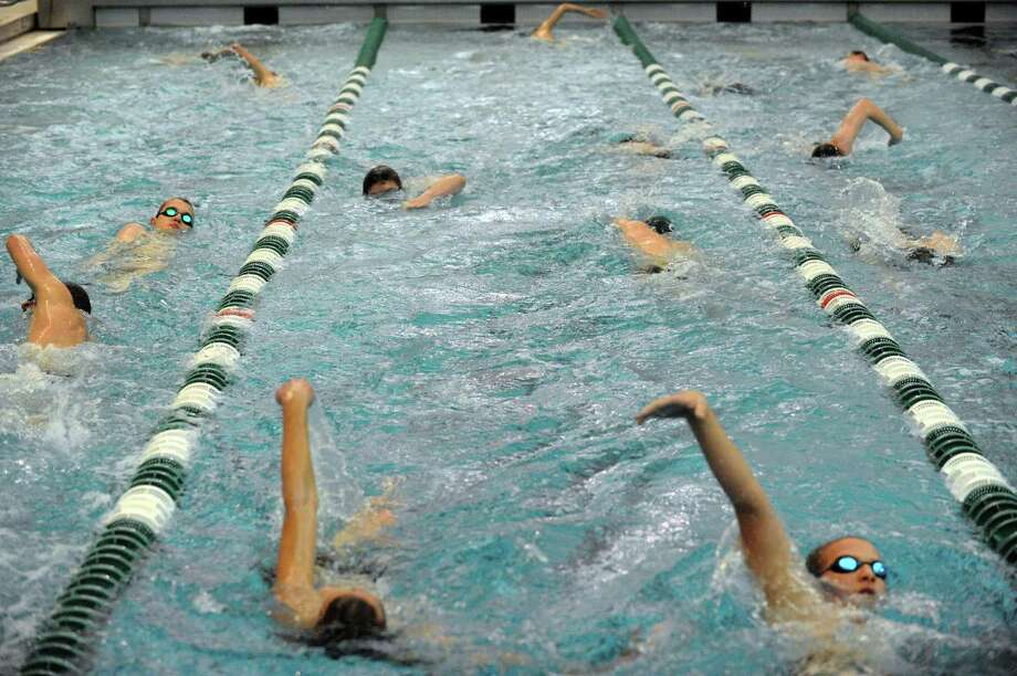 The Shenendehowa swim team warms up prior to their meet against Shaker on Thursday Jan. 17,2013 in Clifton Park, N.Y. (Michael P. Farrell/Times Union) Photo: Michael P. Farrell